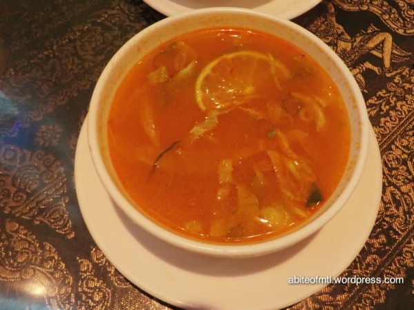 La Petite Mangue - Siem Reap A curry soup with vermicelli, iceberg lettuce, onion and lemon wedge
