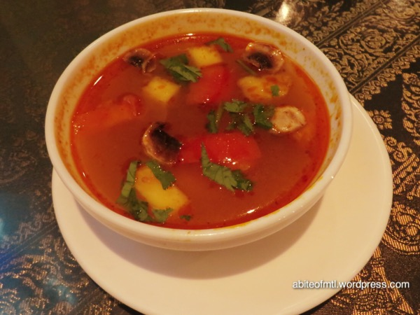 La Petite Mangue - Tom Yum shrimp Tom Yum soup with pineapple, mushroom, tomato and coriander